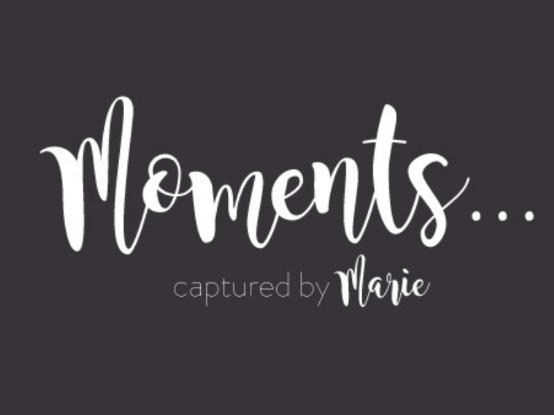 logo for the photographer 'moments captured by marie'