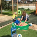 children playing in the garden at rainbow kids childminding